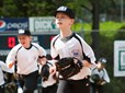 Young baseball players run off the field at Main City Park.
